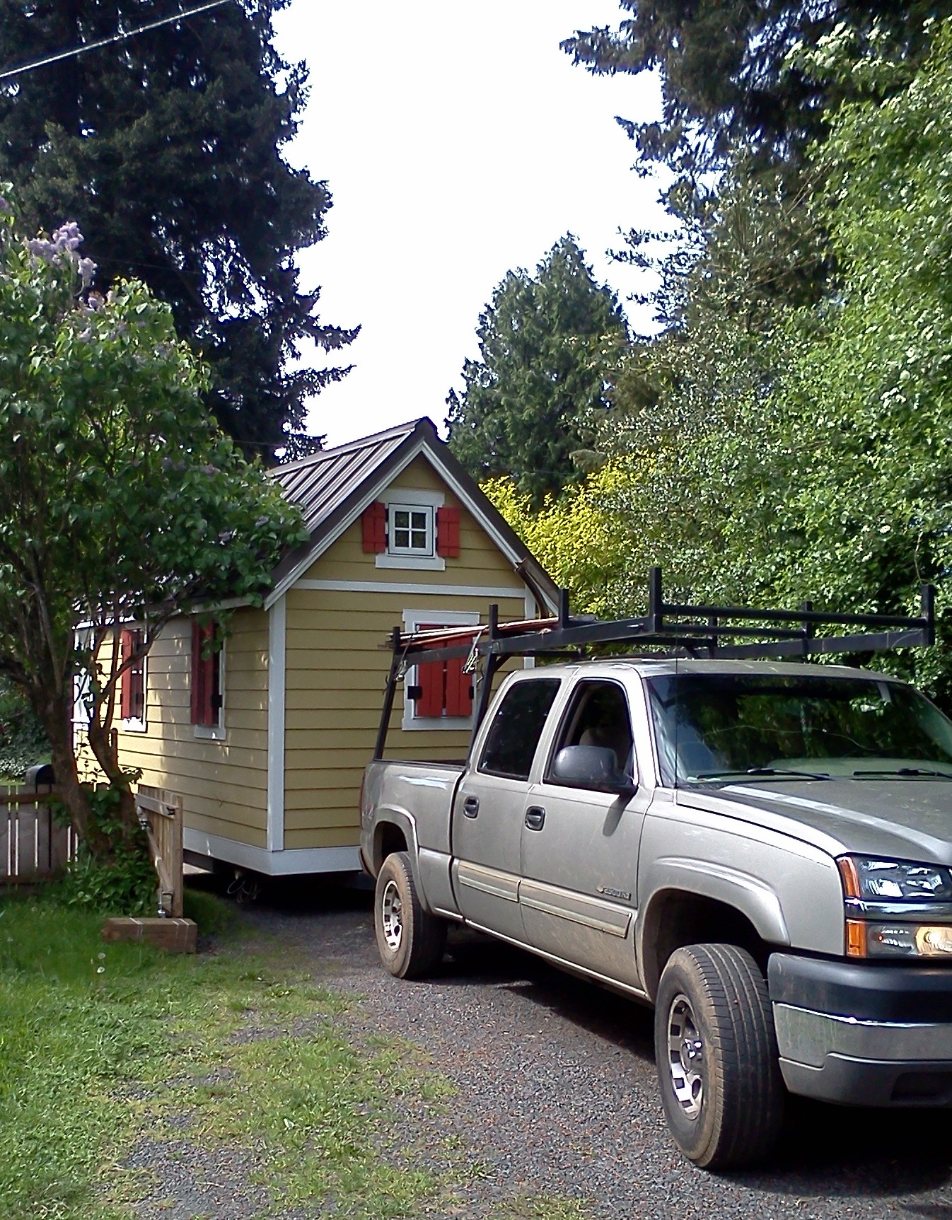 pulling the tiny house into its new parking spot