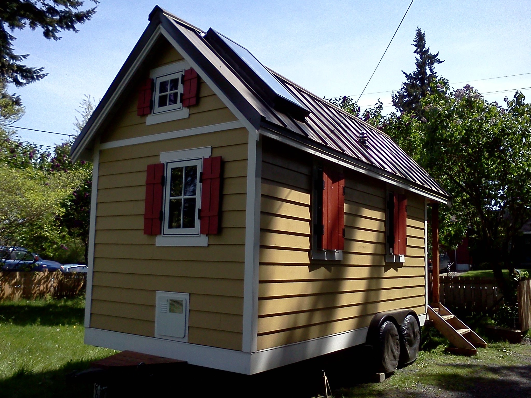tiny house settled into a new parking spot