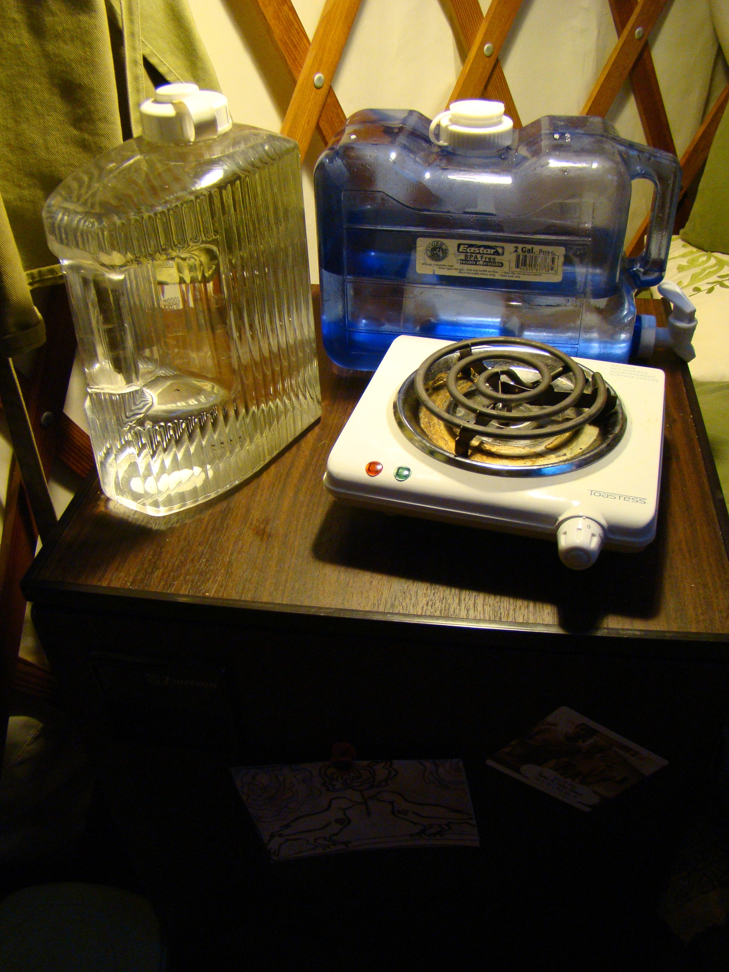 2 water jugs, a 1-burner cooktop, a mini-fridge