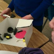 modeling a tiny house with cardstock and clay