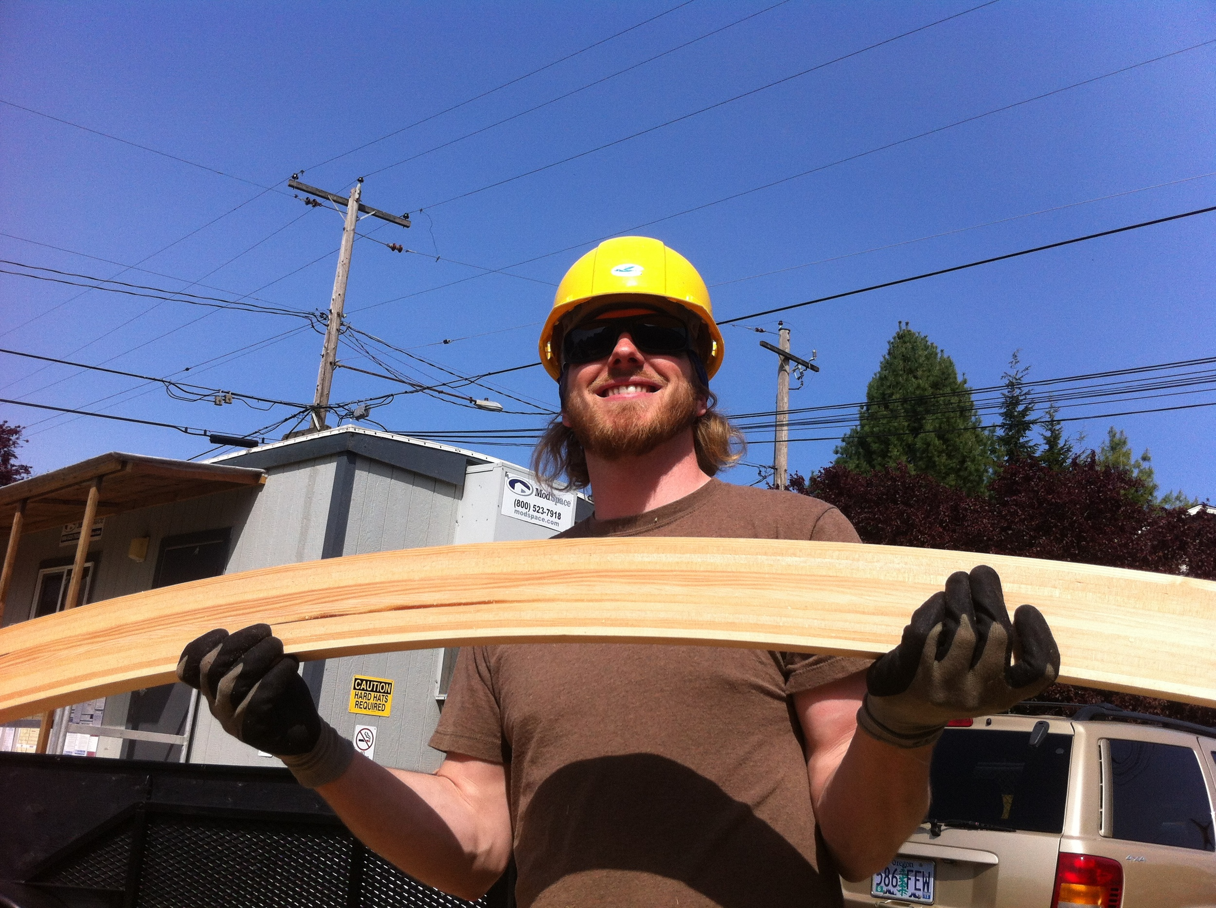 Evan shows off the first planed rafter