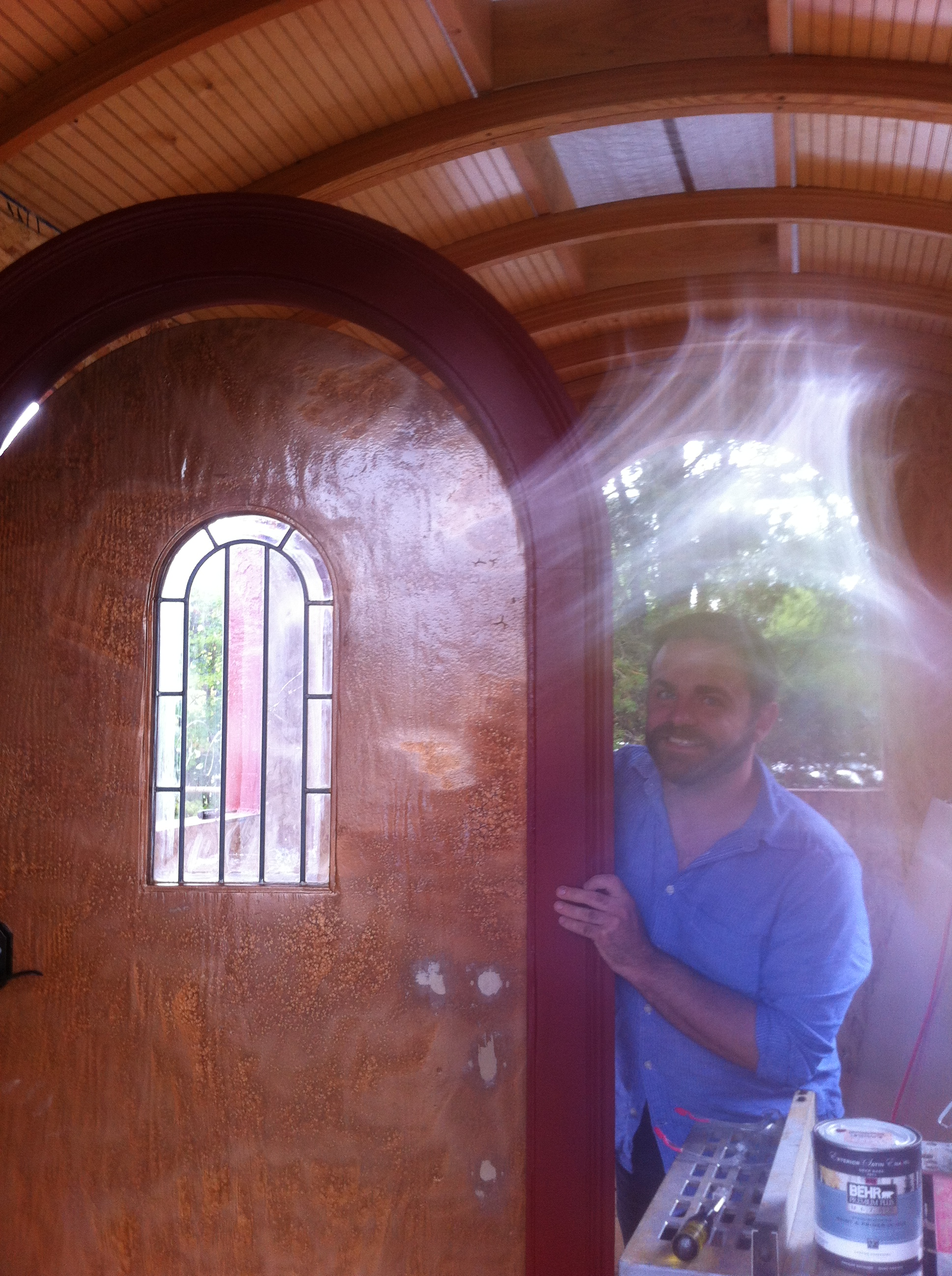 Matthew and the arched door - the paint makes the light jump!