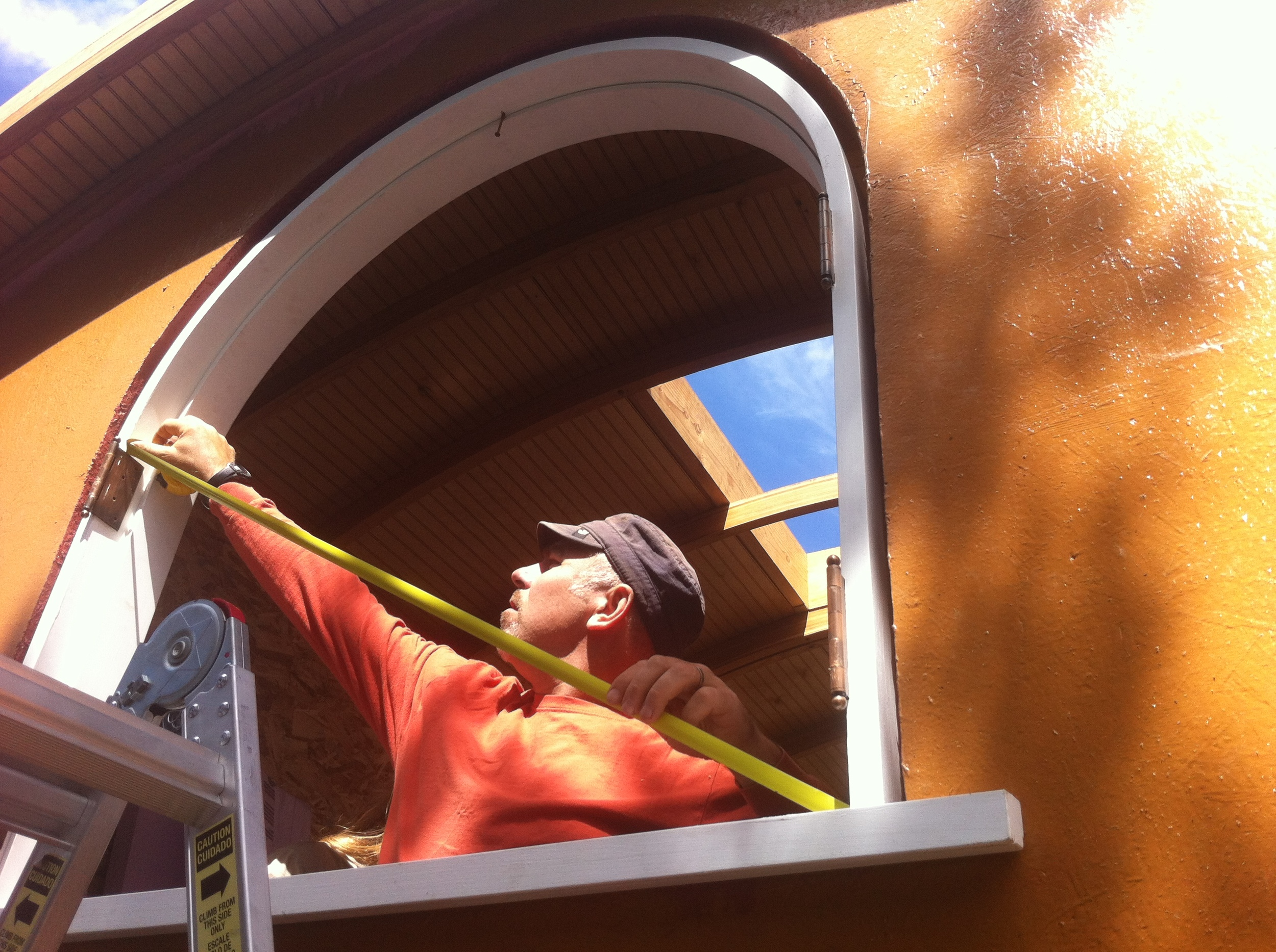 Eric taking diagonals on arched window
