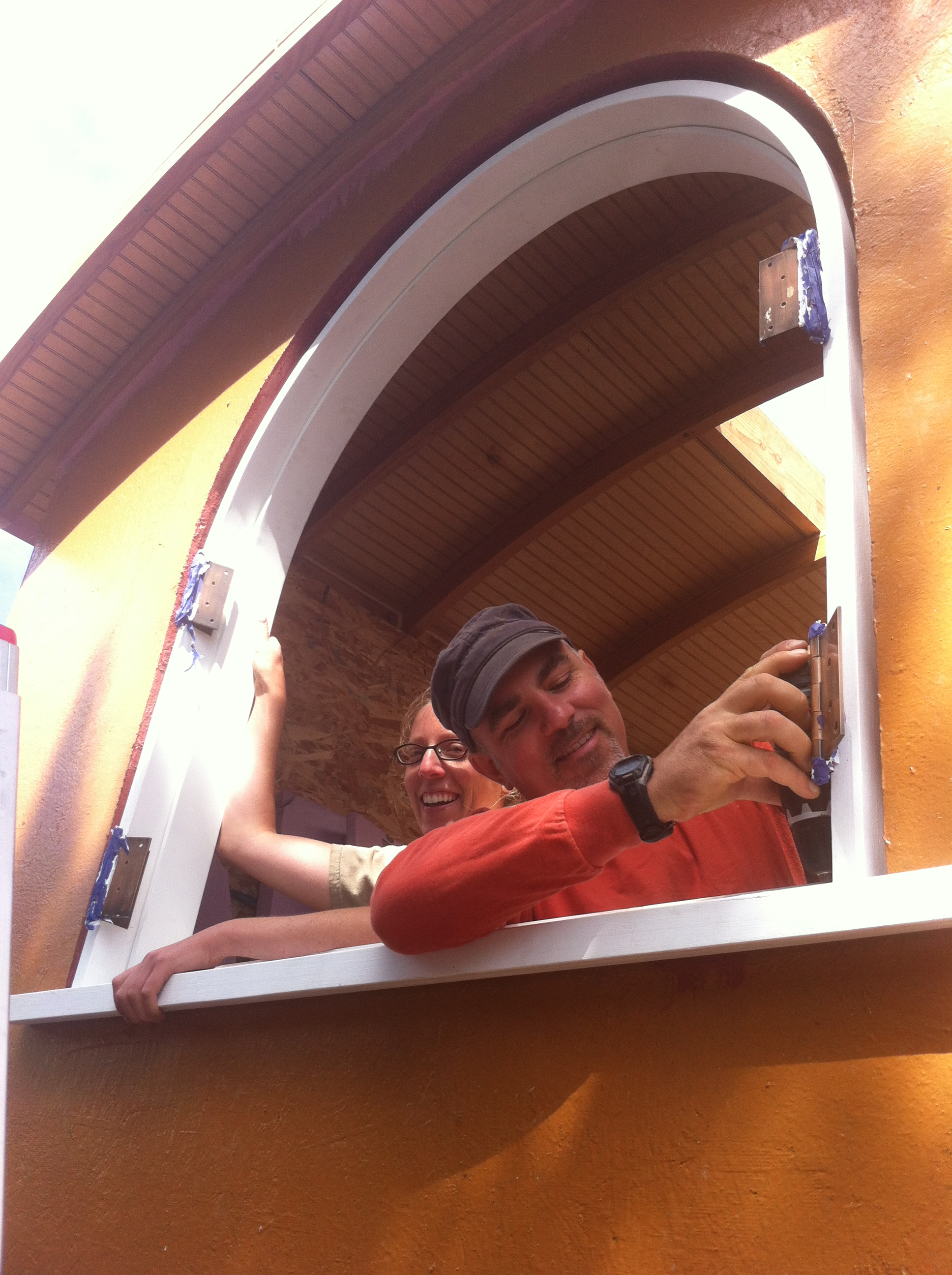 Laura and Eric installing the arched window jamb