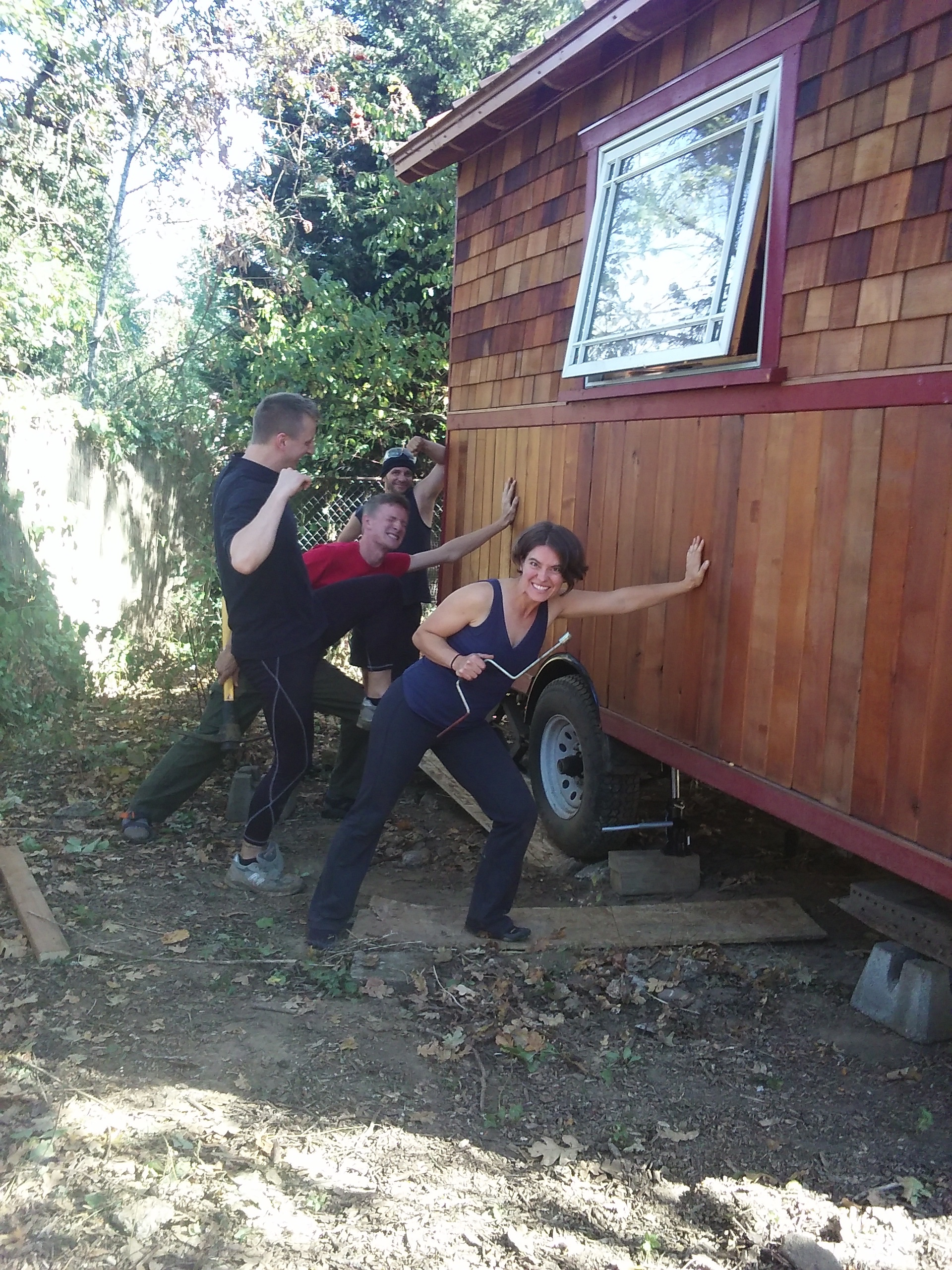 moving tiny houses sometimes requires superhero strength!