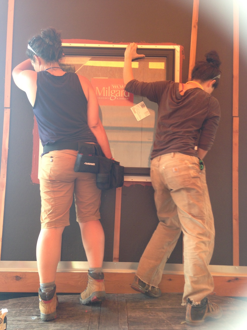 Meg and Sarah installing a window
