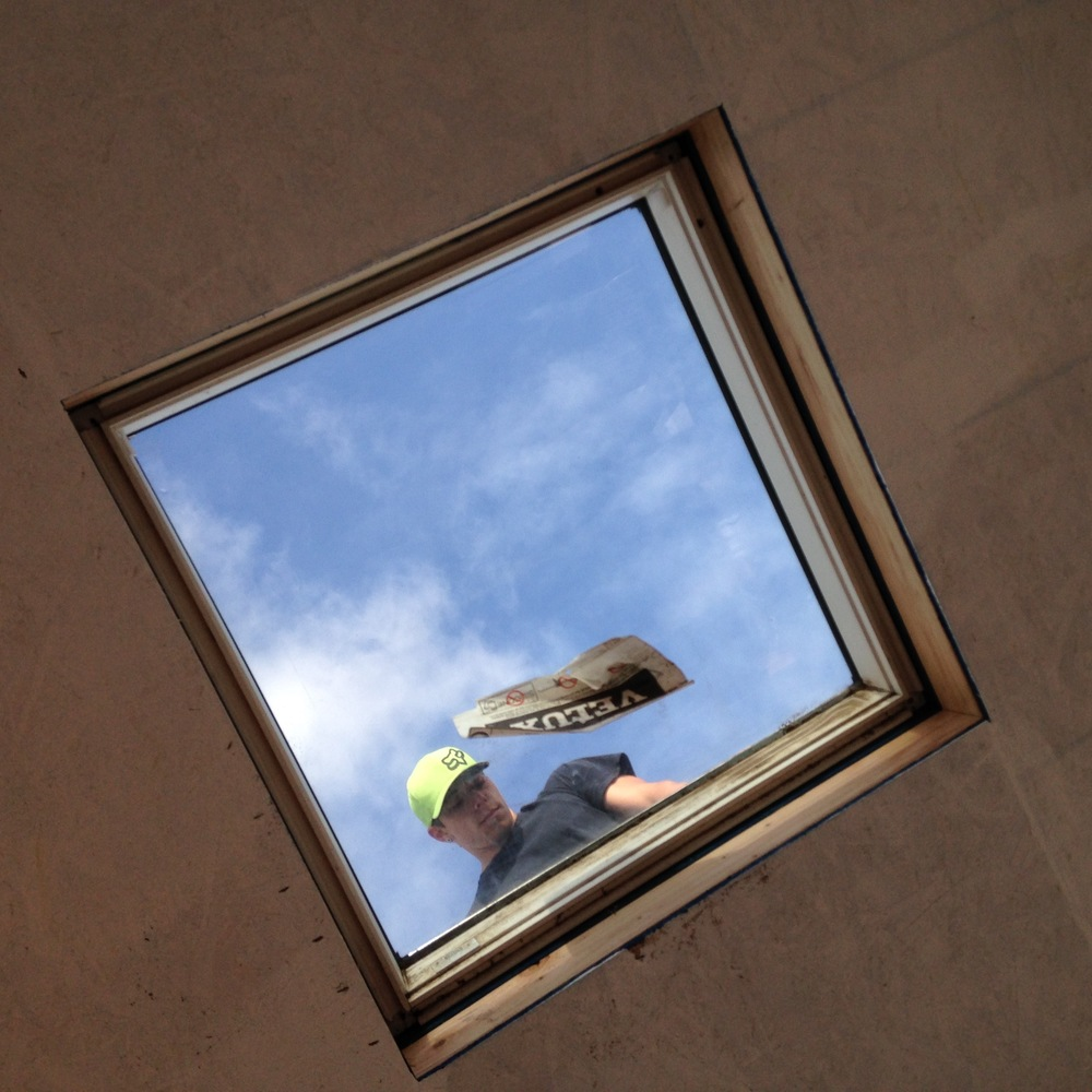 Roofer through Skylight