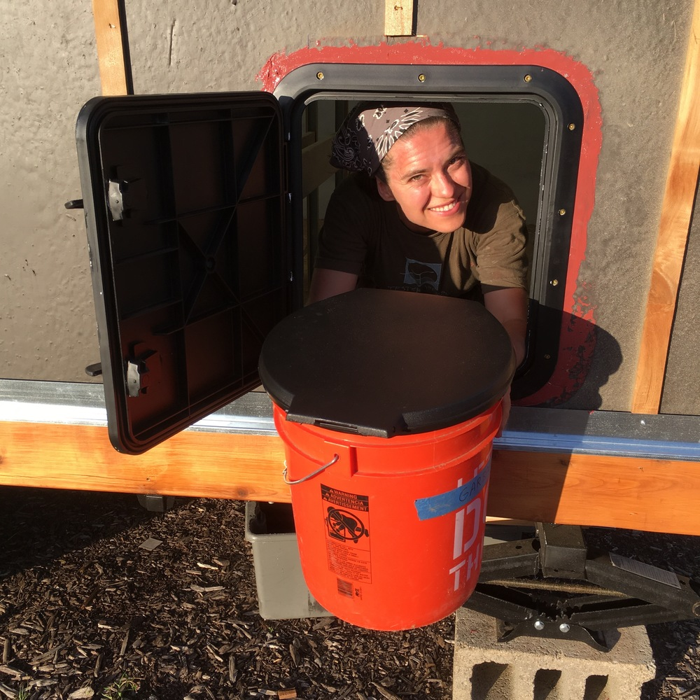 Lina Tests Access Hatch with Loo Bucket