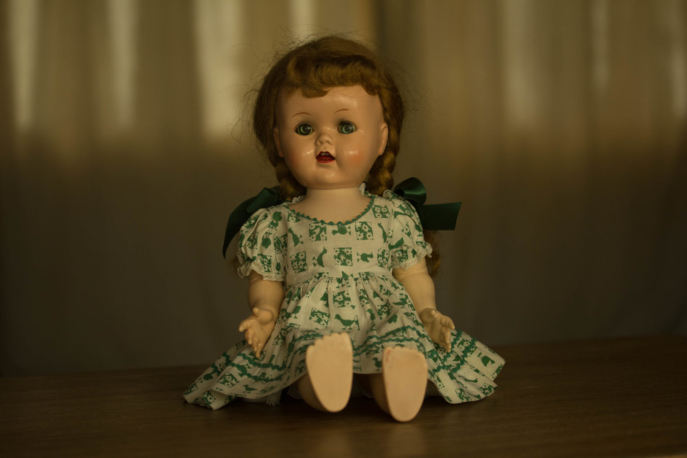 """This is my mother's doll. When I was a girl, this doll lived in a wooden trunk at the foot of my parents' bed. We almost never saw her. But I knew where she hid, and I wanted to play with her. She was simply called, """"Doll."""""""