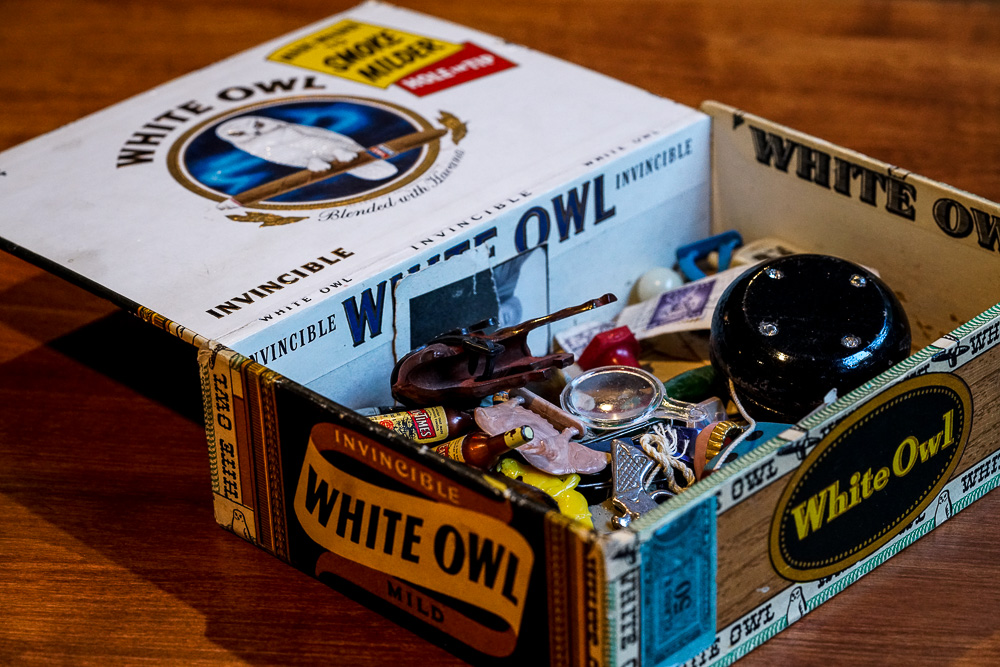 My father's toys, circa 1950. Duncan yo-yo, army soldiers, a plastic pig, false teeth, miniature playing cards, and more. Treasured for more than 60 years inside this White Owl cigar box.