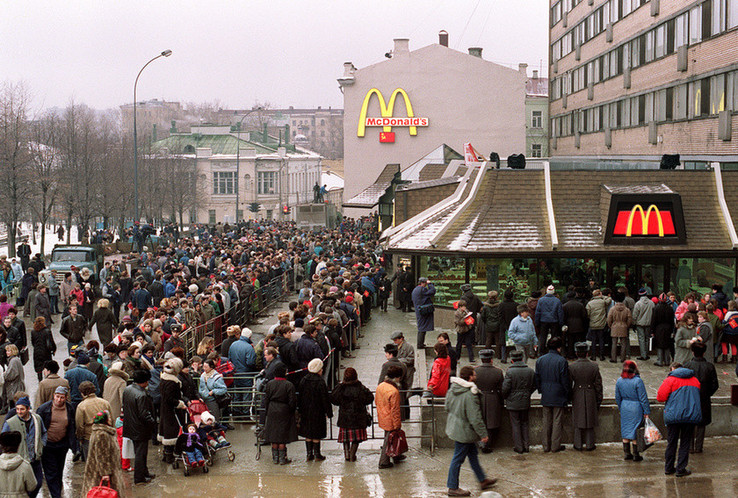 The first McDonald's in the U.S.S.R. gives away free smiles to 30,000 hungry Soviet citizens on opening day