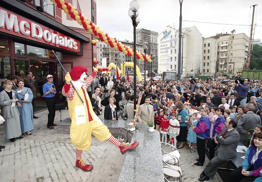 """Traditional Russian proverb:""""Do not believe the clown.  """"Ronald McDonald performs in front of a newly opened McDonald's restaurant in Moscow on August 18, 1995. At the time, this was the fifth McDonald's franchise to open in Moscow."""" —Alan Taylor of  The Atlantic , Photo: Alexander Zemlianichenko/AP"""