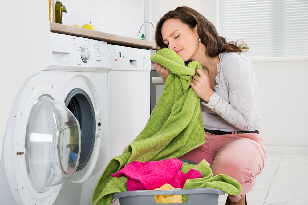 We can't guarantee you'll love doing laundry as much as this lady, but you'll be happy to be more efficient by converting to gas!