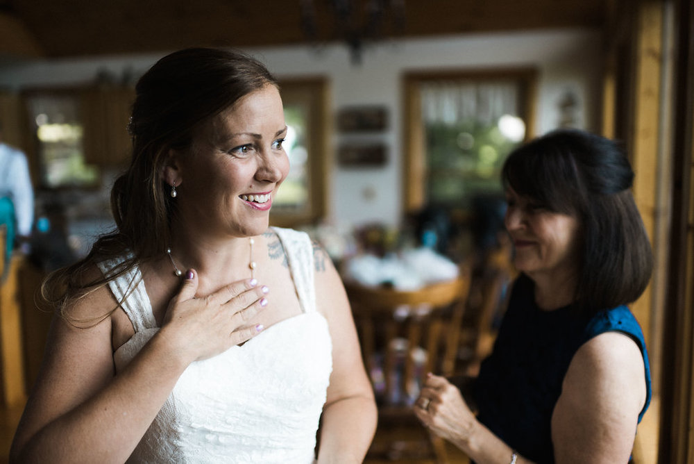mom getting ready with bride