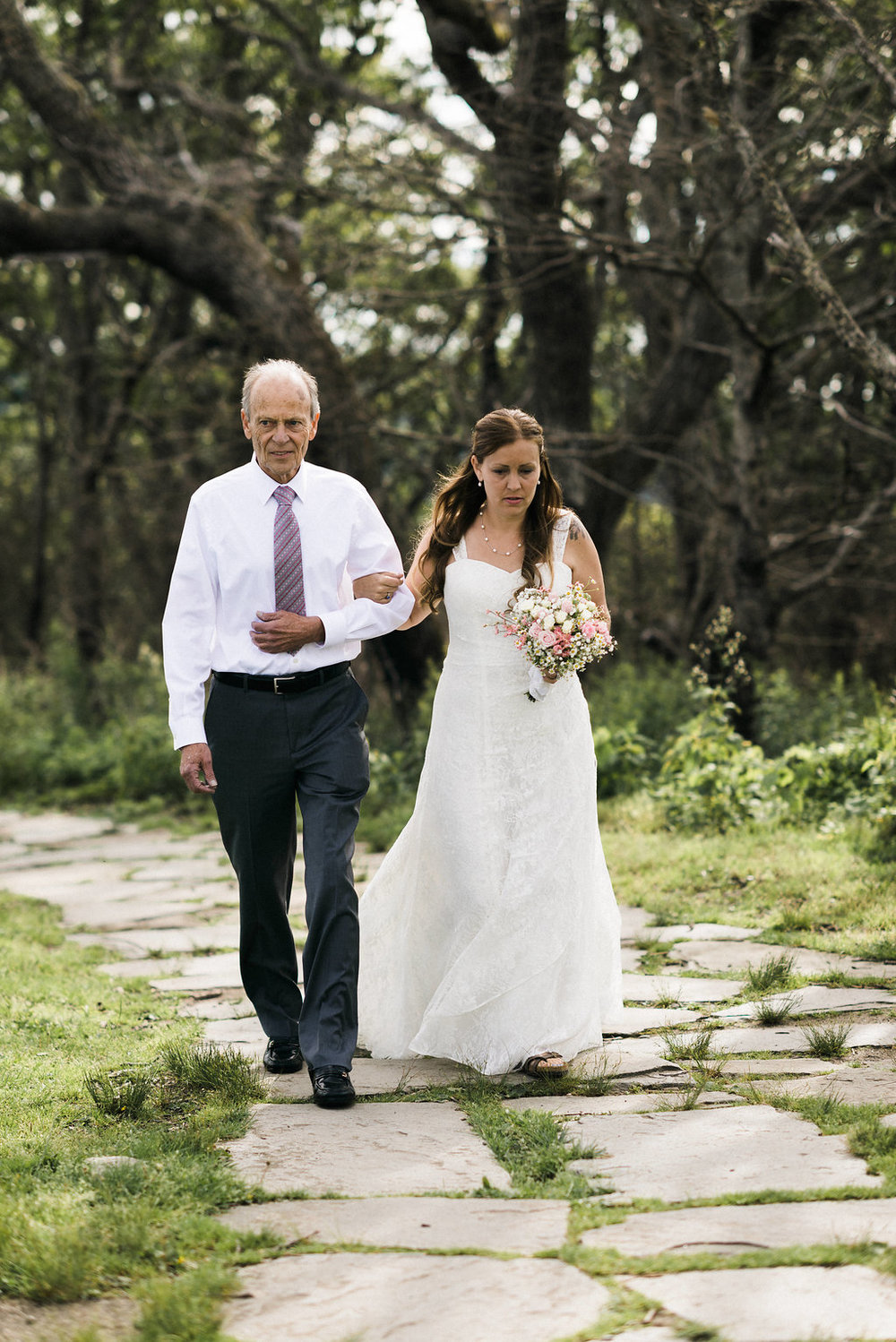 father of the bride walks bride