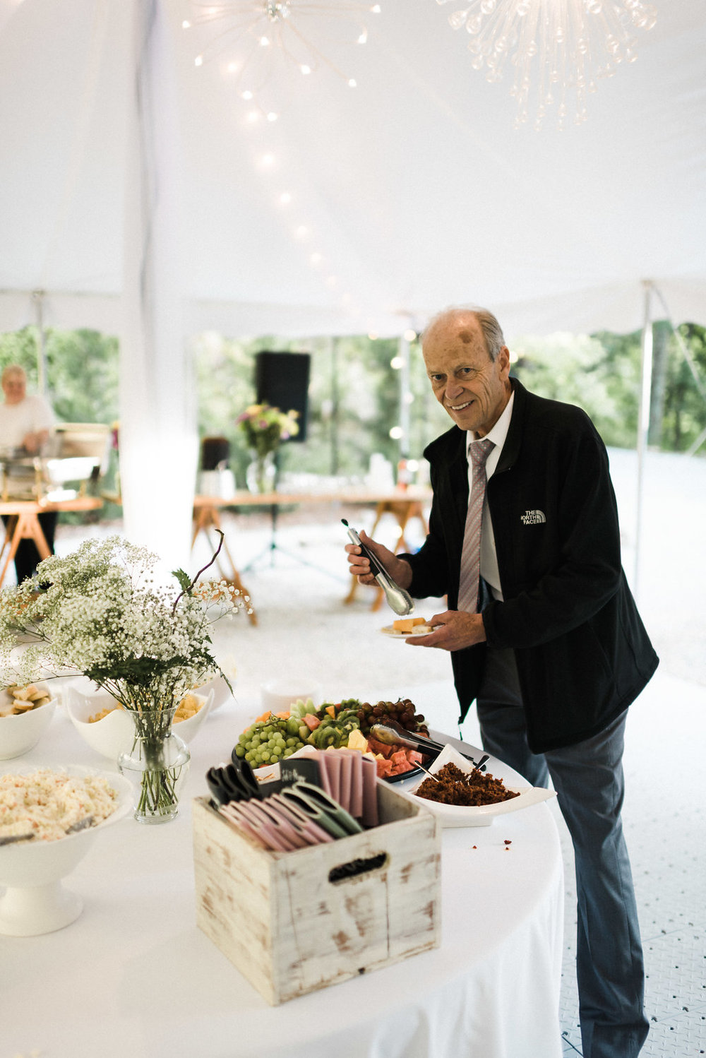 father of the bride prepping reception