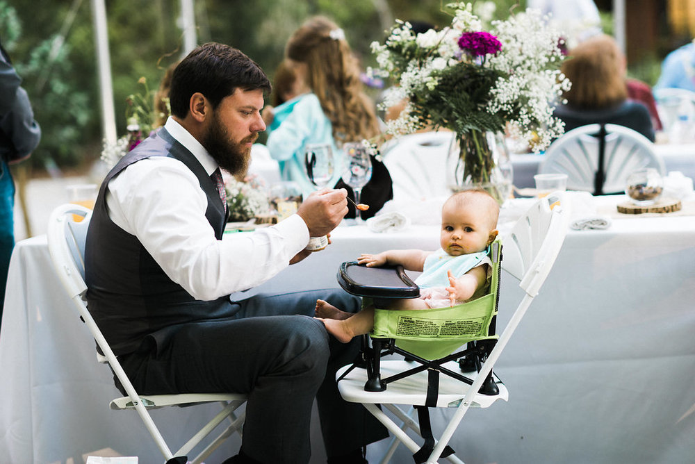 groom feeing daughter