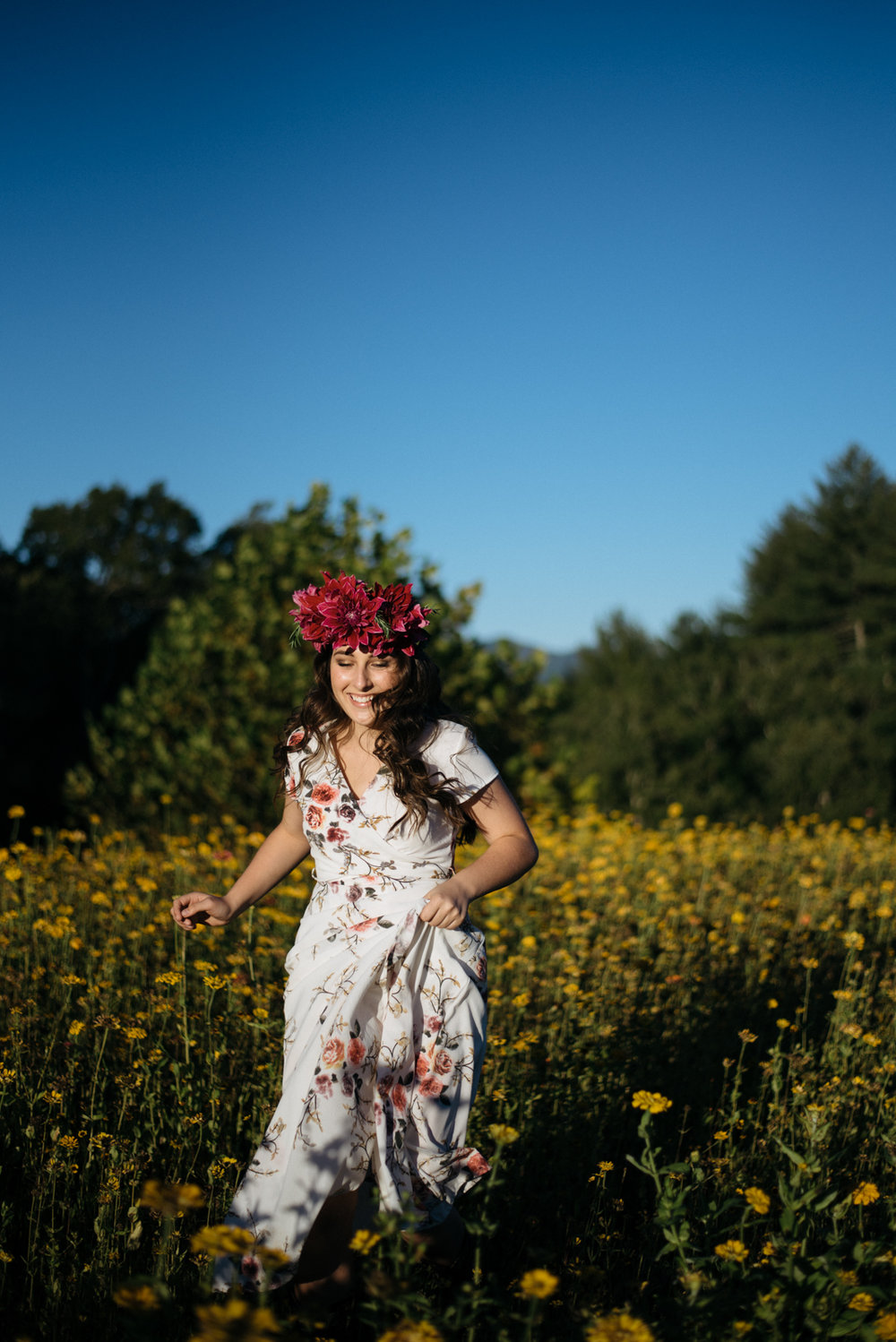 flower crown on girl running in field