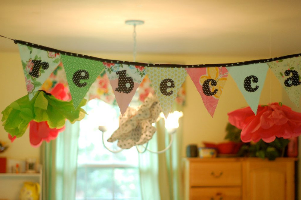 A banner I made when I threw my friend a baby shower several years ago. She hung it in the baby's nursery!