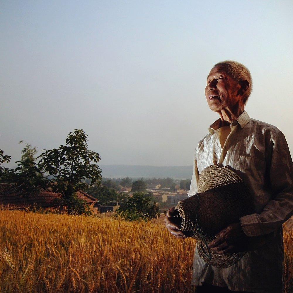 A portrait of a 80 year old farmer still working the land. Photographed for Caixin Magazine.