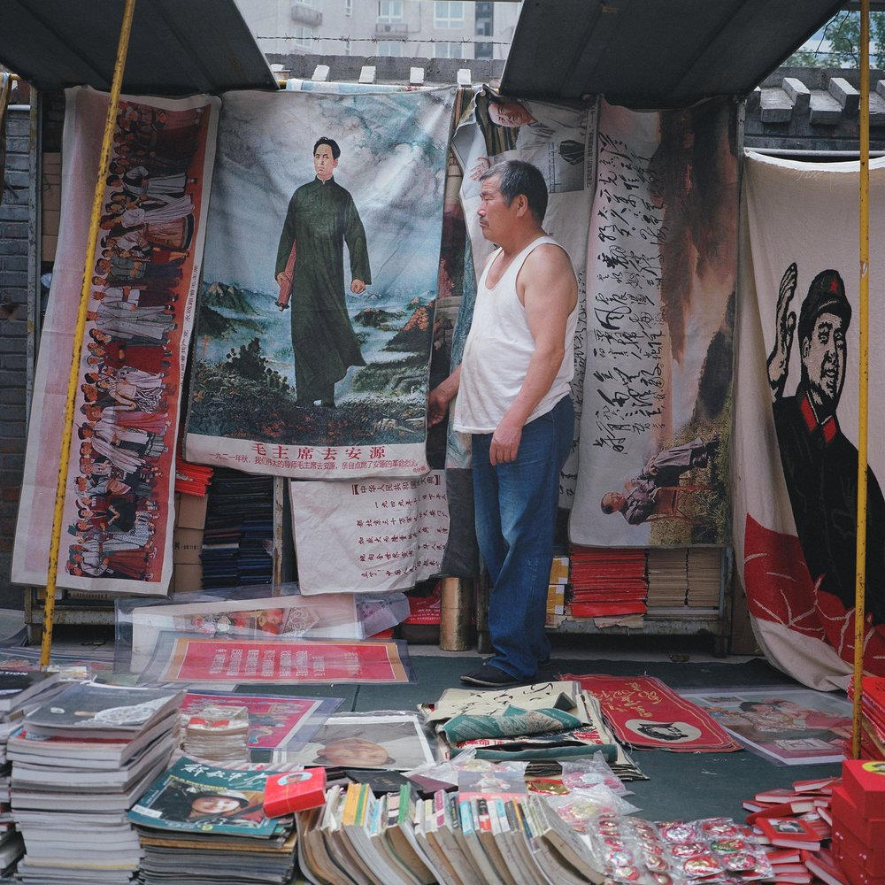 A man selling Mao memorabilia. Photographed for Inspire Magazine