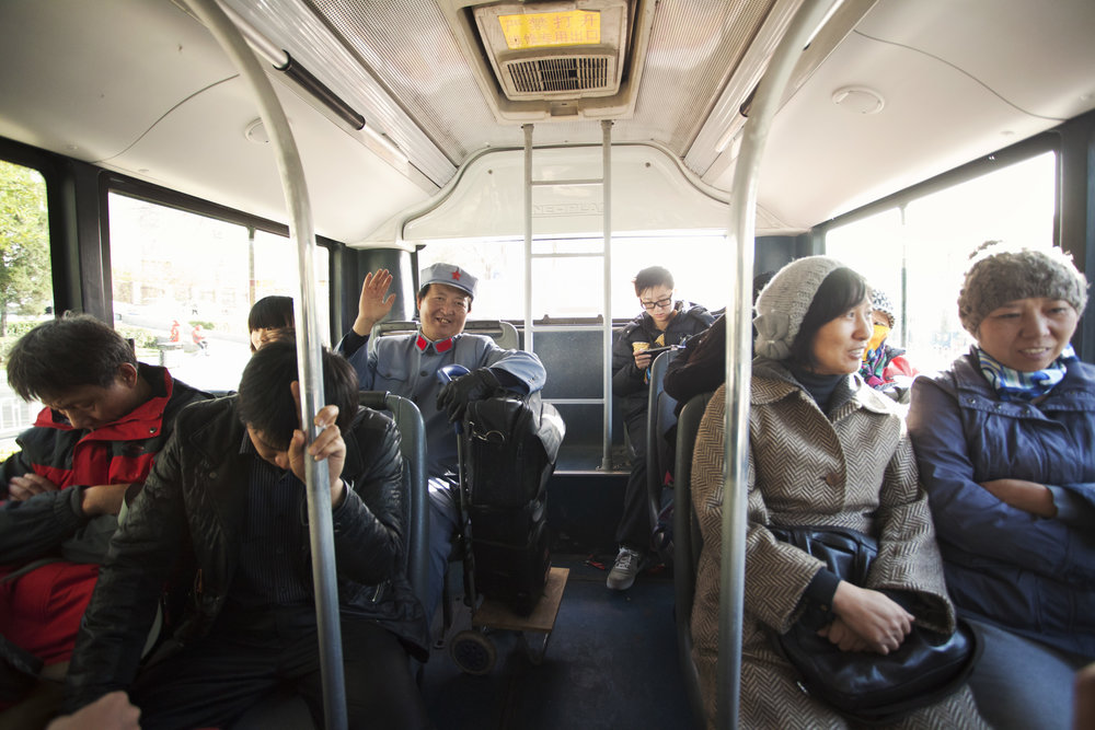 A Mao impersonator rides the bus in Beijing. Photographed for Auto de Fe Magazine