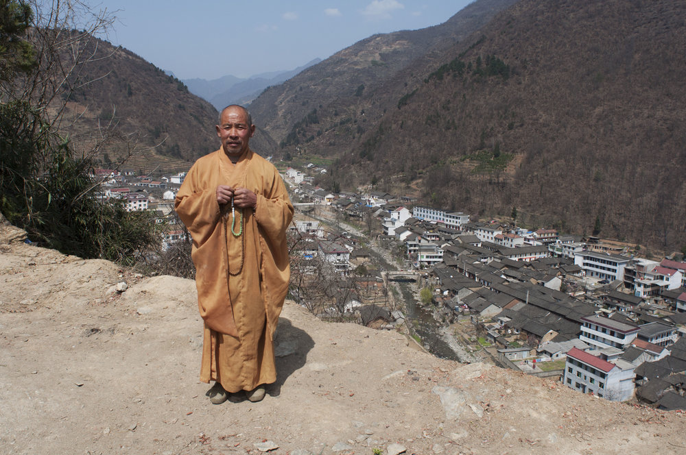 The last monk left in a run-down hilltop monastery. Shaanxi Province. Photographed for China Pictorial