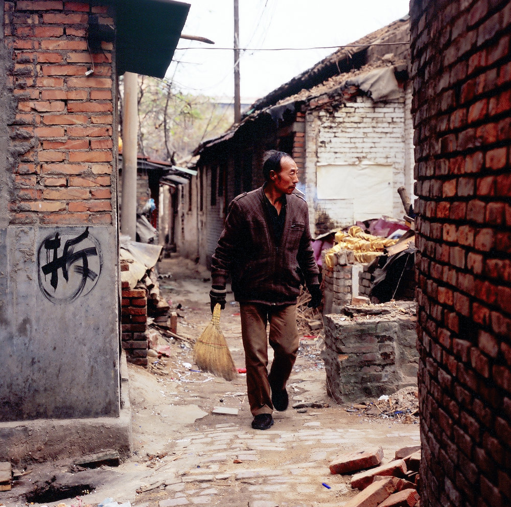 Mr Zhang, a protestor in a traditional hutong alley scheduled for demolition.