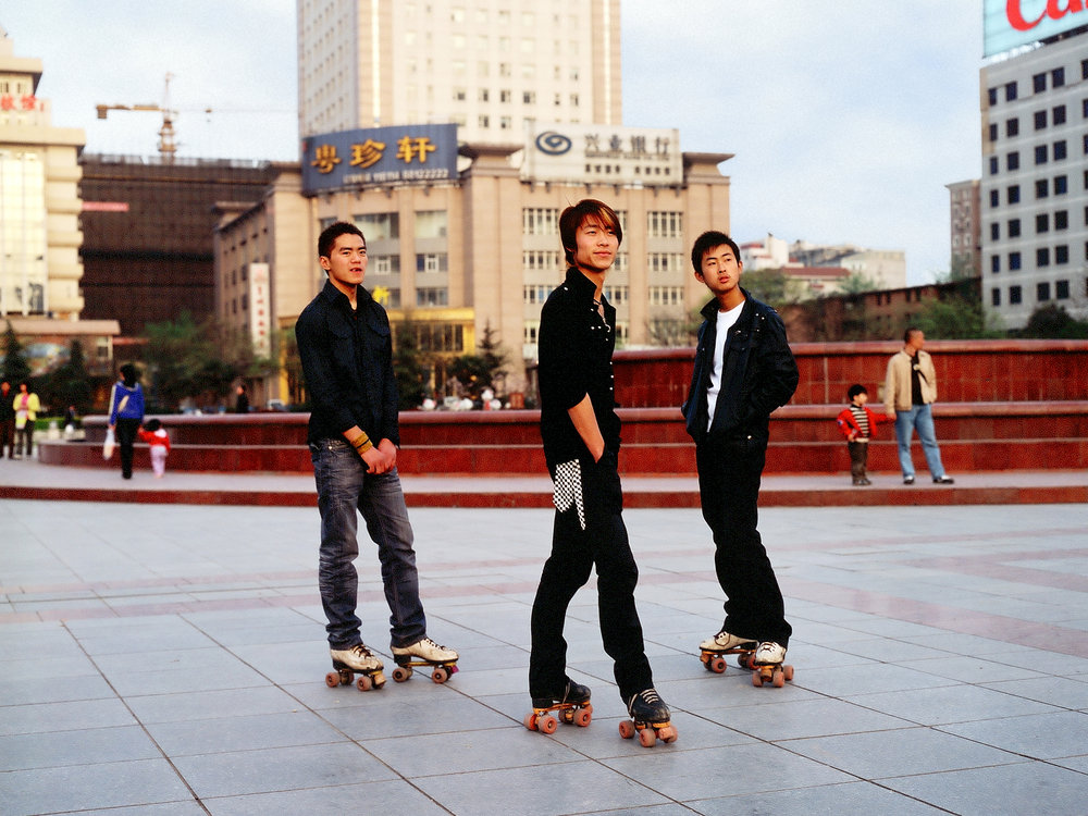 Three youths on rollerskates, Xian. Photographed for Caixin Weekly