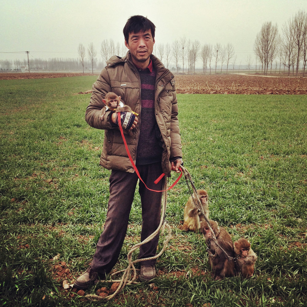 A farmer in Henan Province who trains monkeys to do tricks, travelling around China and busking with them on the streets.
