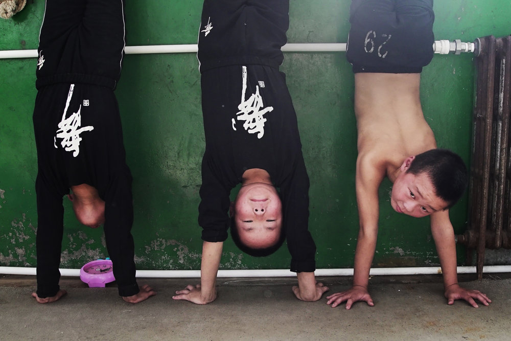 Little acrobats learning handstands. Photographed for Al Jazeera.
