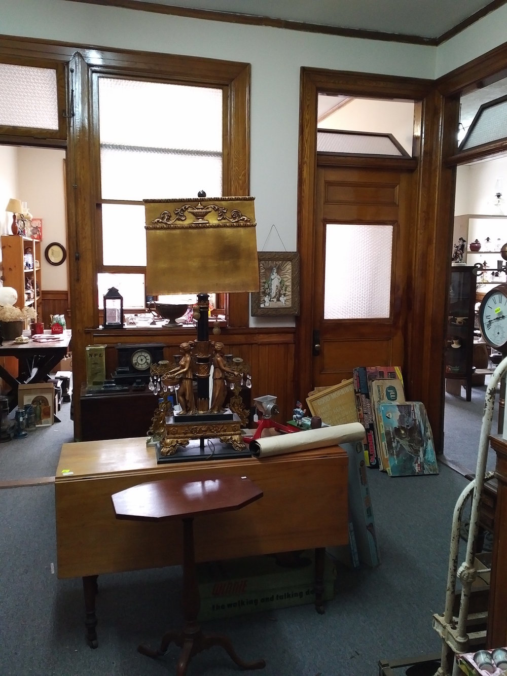 Hilltop Antiques retains much of the architecture of the old office space -- frosted glass windows and interior doors separating the offices.
