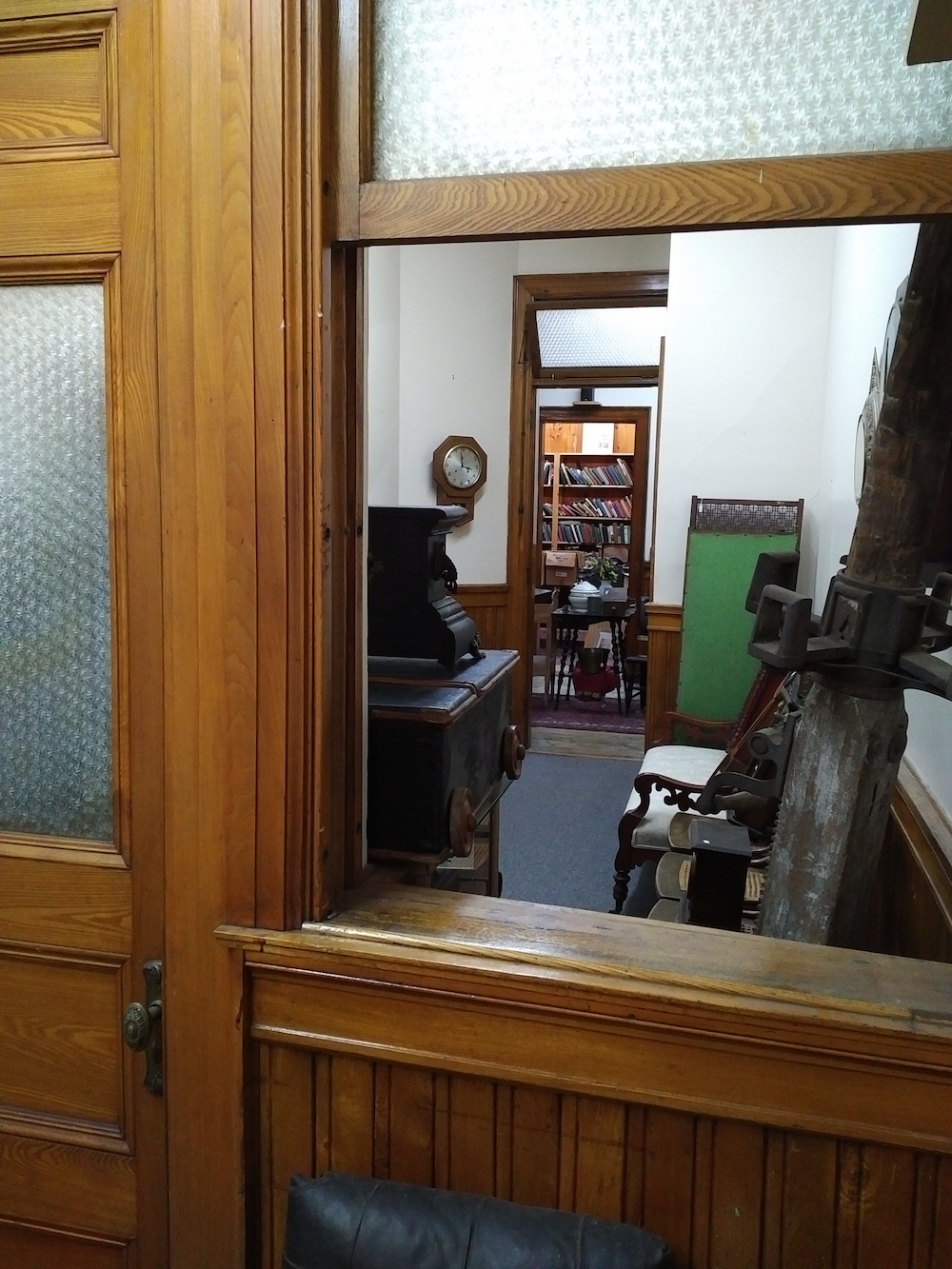 Peeking through the window into the next room of vintage treasures. . .