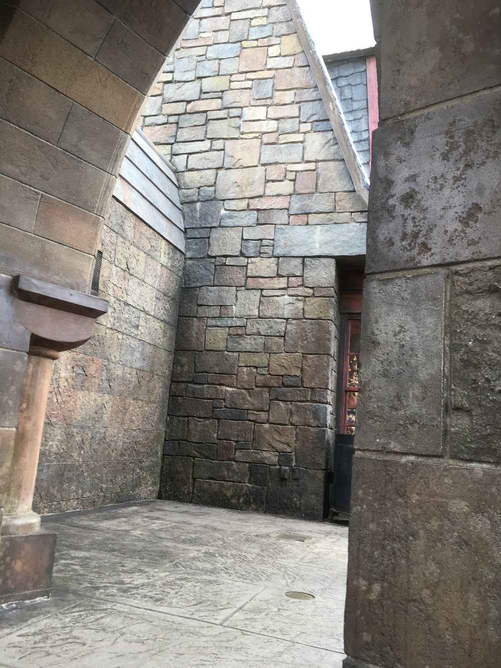 This is in Hogsmeade, the archway where we've begun a tradition of sitting underneath while I enjoy some pumpkin juice and stuff my face with a Cauldron Cake.