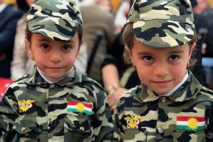 Kids wearing uniforms with father's rank