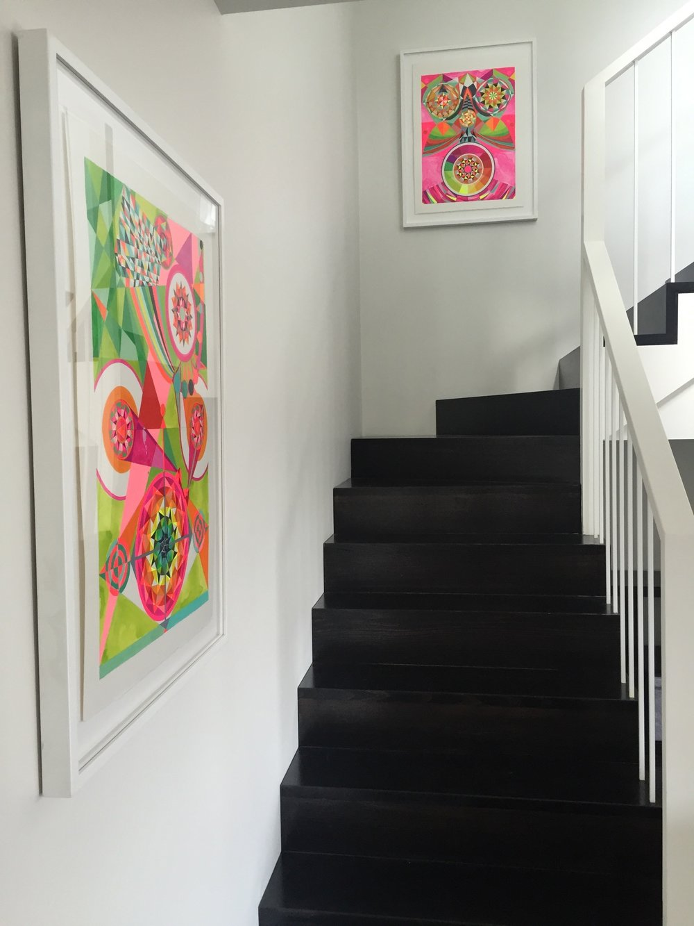 Amazing colourful framed artwork creates such a different with pops of colour!