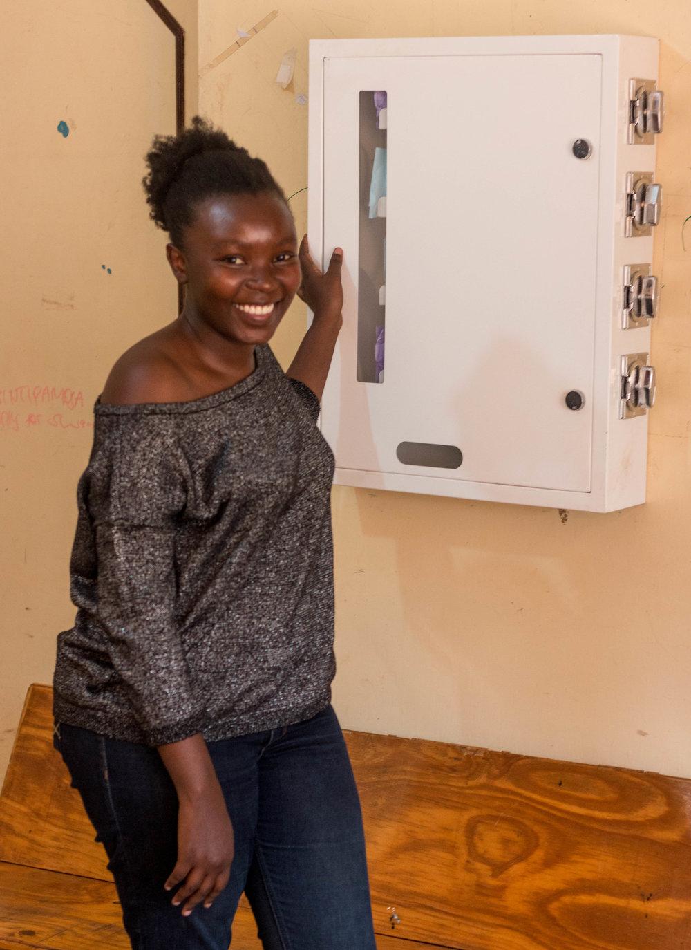 Esther Mwangi with the Evendo machine at Binti Pamoja in Kibera