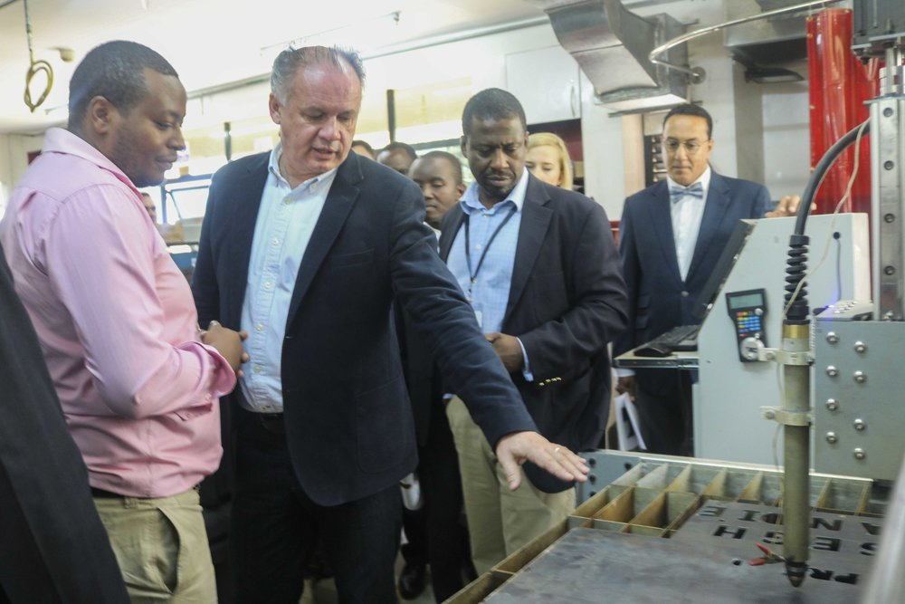 President Andrej Kiska being taken through a demo of the hybrid CNC router and plasma cutter made at Gearbox
