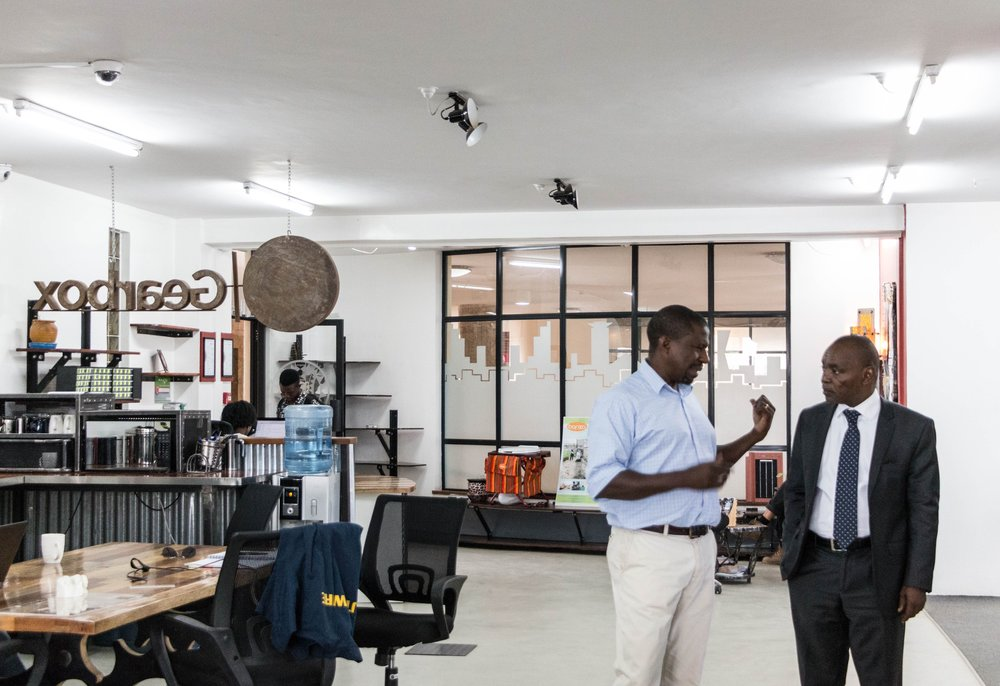 Gearbox Executive Director, Dr. Kamau Gachigi, welcomes Statehouse deputy comptroller, George Kariuki, to the makerspace