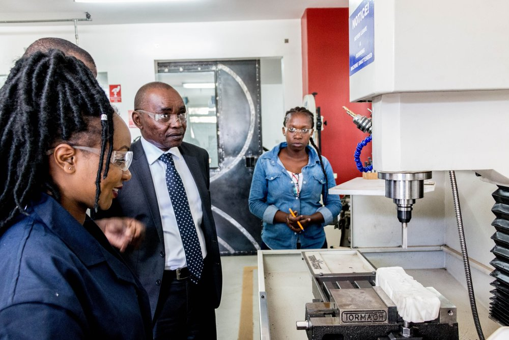 From right Brenda Livoi, Gearbox mechanical lead, George Kariuki and Ester Wanjiru, a Gearbox intern during the demonstration of the CNC milling machine