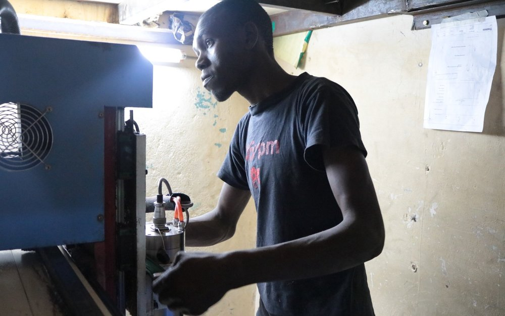 Richard prepares his job shop's CNC router in Nairobi for a contract from Gearbox.
