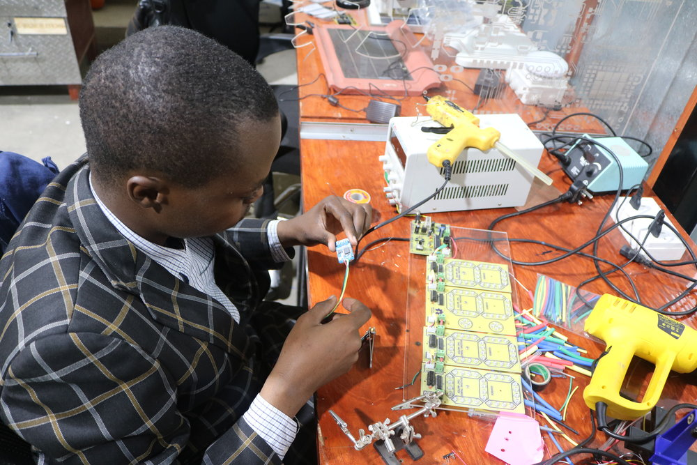Mumo, an electrical engineer finishing up on the clock