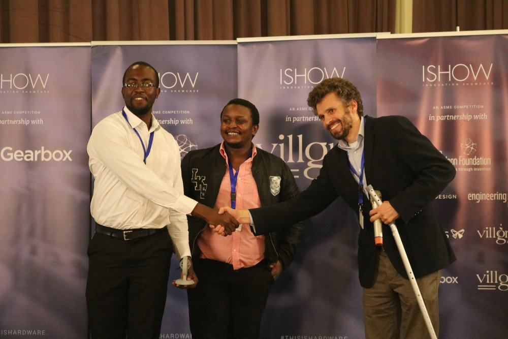 George Chege receiving an award an ISHOW
