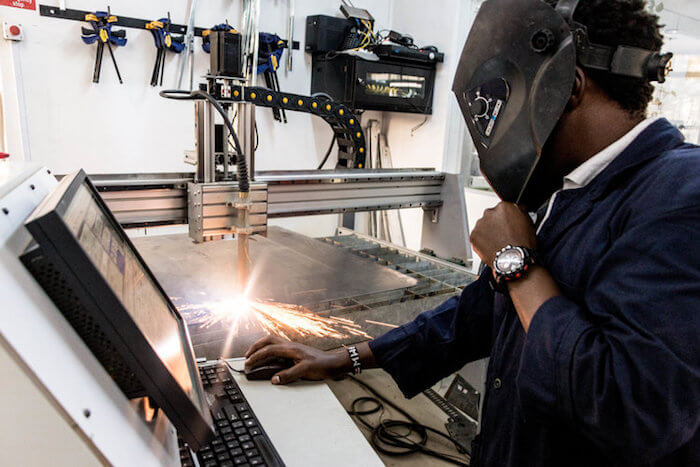 A worker takes advantage of the advanced tools available at the Gearbox makerspace in Nairobi, Kenya. Courtesy Gearbox.