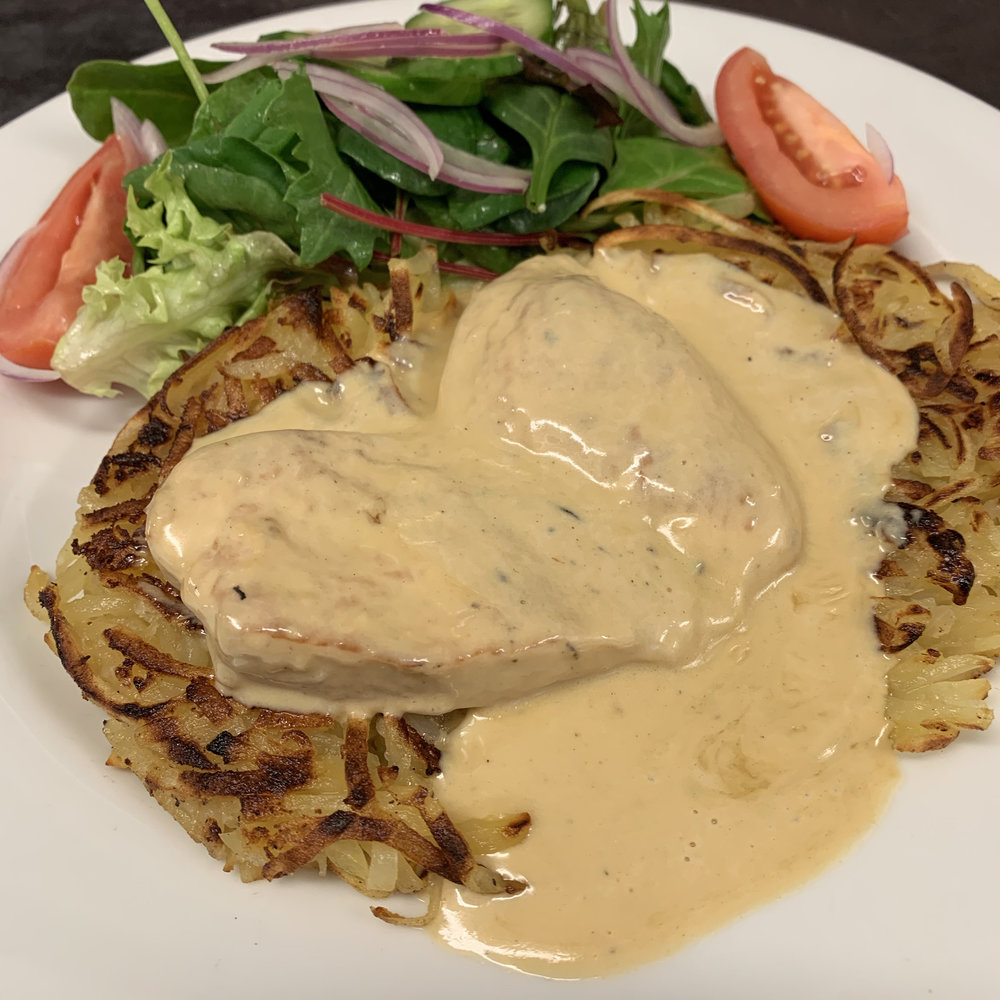 Chicken Breast Fillet - pan fried with a lemon segment and dijon mustard cream sauce served with rosti potato and salad