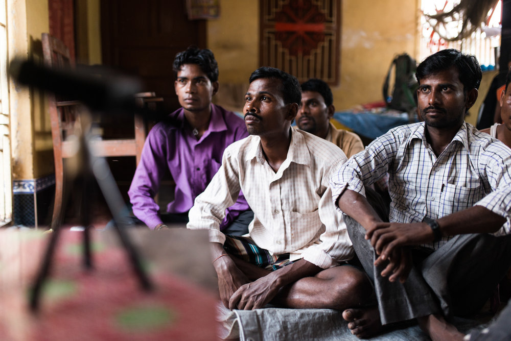 October, 2016. Patori Block, Samastipur district, Bihar, India.   A group of men watch an educational video on family planning for men's group meeting in the village. Pankaj, the Village Health Champion for ABT Associates meets men individually to discuss about family planning options and debunk their myths and superstitions.