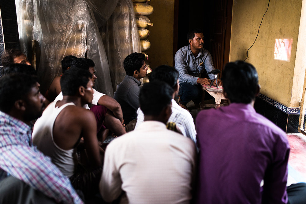 October, 2016. Patori Block, Samastipur district, Bihar, India.   Pankaj, Village Health Champion of ABT Associates plays an educational video on family planning for men's group meeting in the village. He meets men individually to discuss about family planning options and debunk their myths and superstitions.