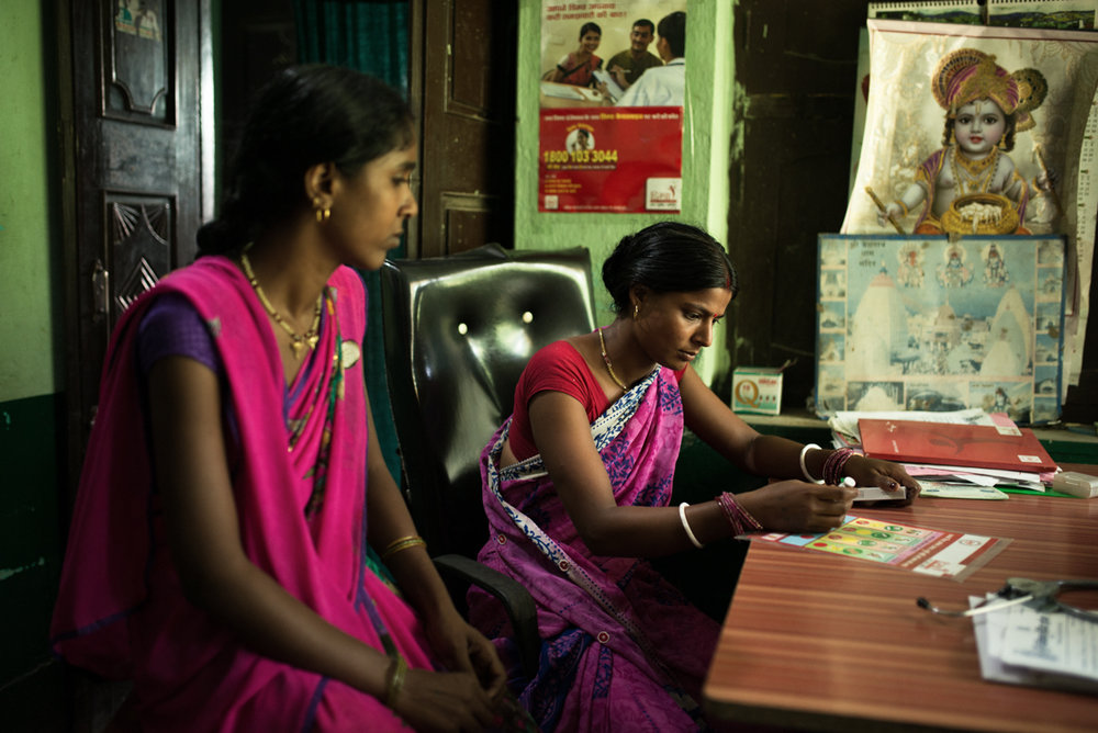 October, 2016.Vishnu Nursing Home, Samastipur district, Bihar, India.  Premsheela Kumari (left) and Mamta Devi of Jalpur Village in Samastipur district consults the Resident Doctor of Vishnu Nursing Home on family planning options.
