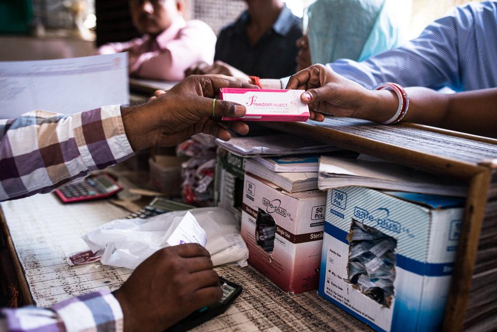 October, 2016.Agra, Uttar Pradesh, India.  A pharmacy store owner selling a DMPA kit.