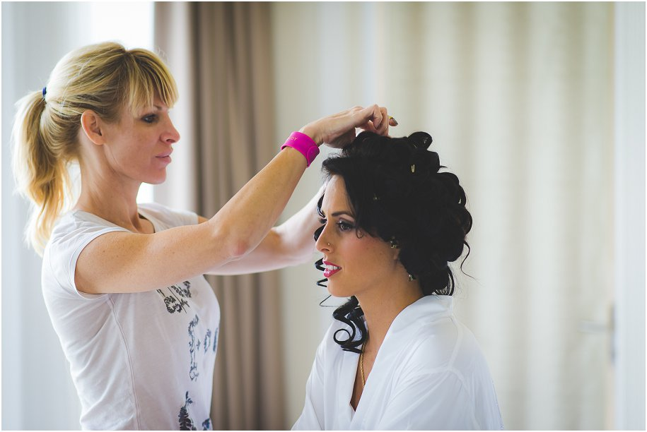 a bride gets style for her wedding in gorgeous natural light at the suites in the Westin Hotel, Cape Coral Florida